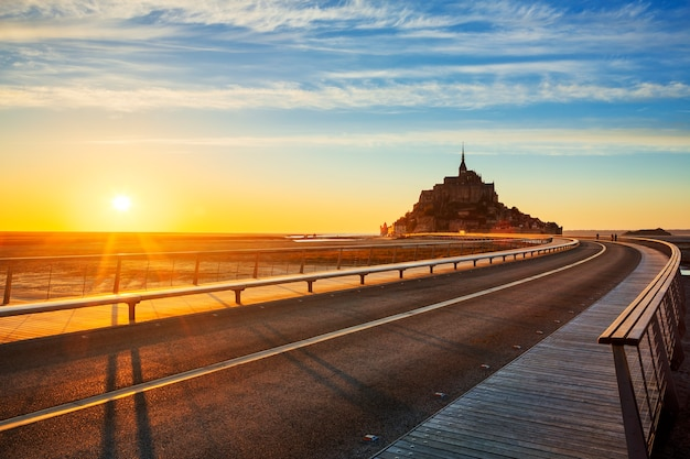 Road to mont saint michel at sunset, normandy. france. Free Photo