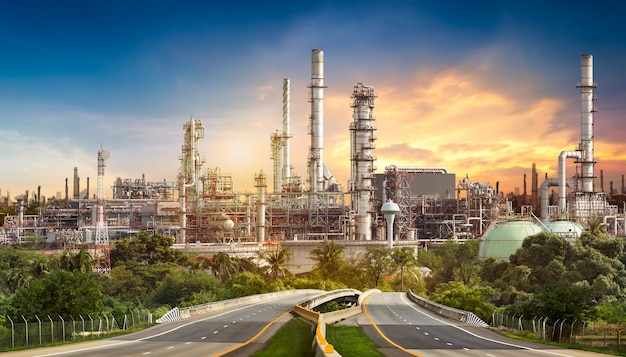 Road to the oil refiner on blue sky in sunset time Premium Photo