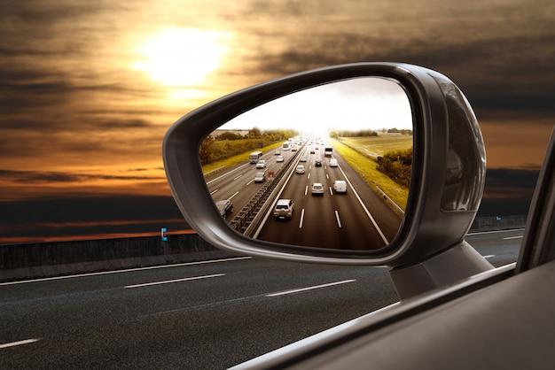 Road in rearview mirror Premium Photo