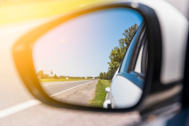 Road reflected on side mirror Free Photo