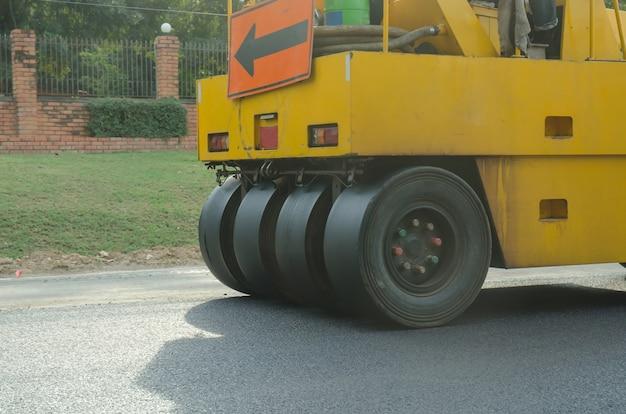 Road roller machine works on the fresh asphalt, asphalt road