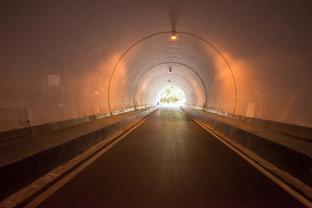 Road tunnel, night illuminated Free Photo