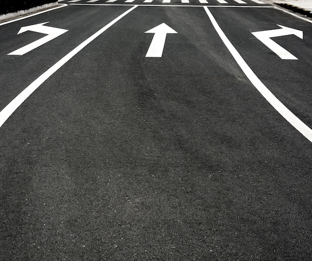 Road with three arrows Free Photo