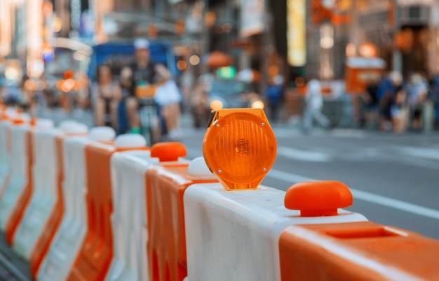 Roadblock or construction site lock with signal on a road. red and white street barricade. Premium Photo