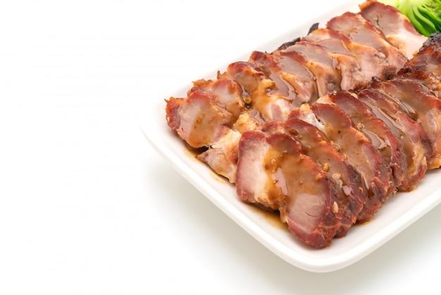 Roast barbecue red pork  with sauce Premium Photo