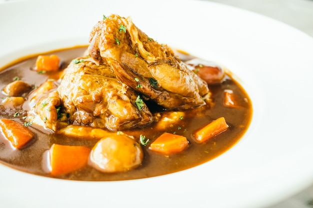 Roast chicken with red wine sauce Free Photo