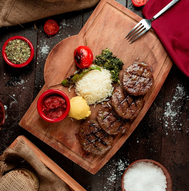 Roasted beef slices with sauce and rice Free Photo