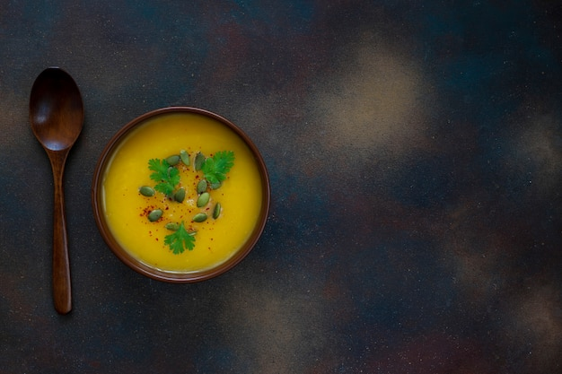 Roasted butternut squash cream soup with pumpkin seeds Free Photo