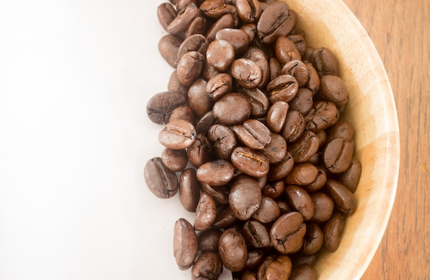 Roasted coffee bean in bowl Premium Photo
