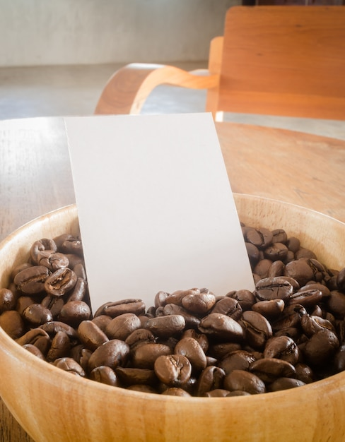 Roasted coffee bean and business card Premium Photo