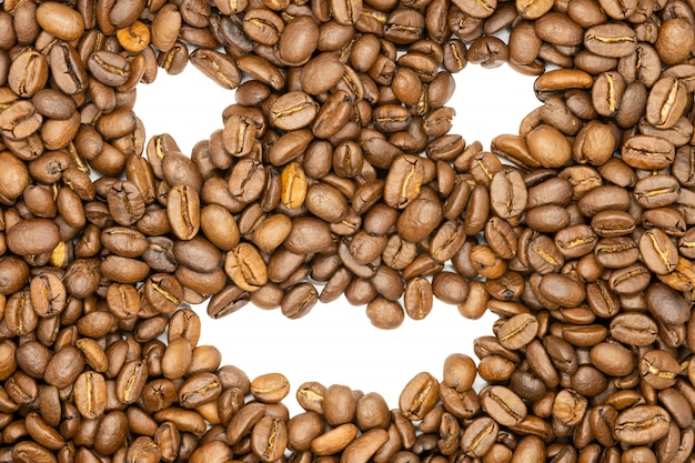 Roasted coffee beans, funny smile face, close up. Premium Photo