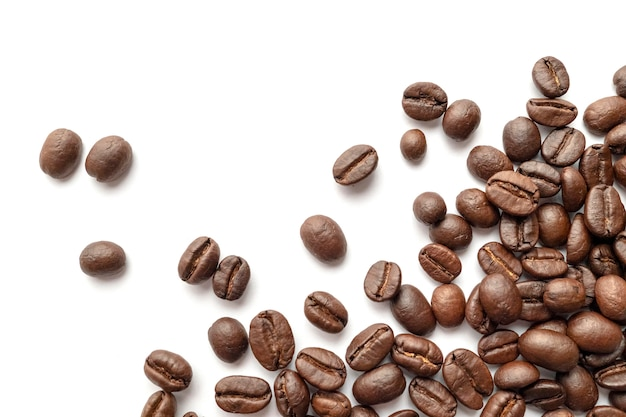 Roasted coffee beans isolated on white background. close ...