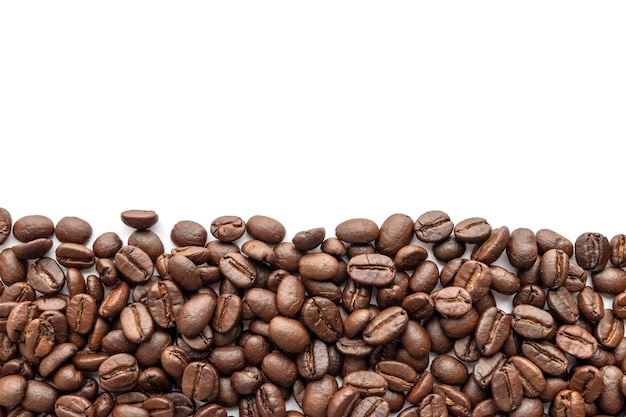 Roasted coffee beans on white background. close-up. Premium Photo