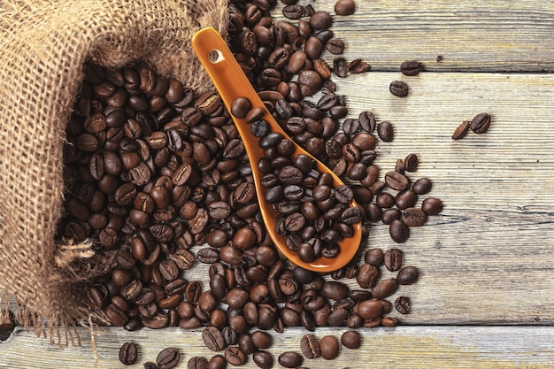 Roasted coffee beans on a wooden floor Premium Photo