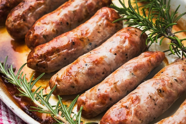 Roasted meat sausages served on plate Free Photo