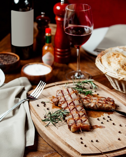 Roasted meat with glass of wine Free Photo