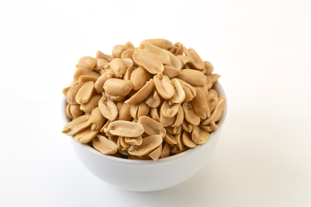 Roasted peanuts and salt in a bowl Premium Photo