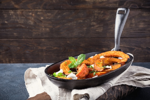 Roasted pumpkin with addition aromatic herbs Premium Photo