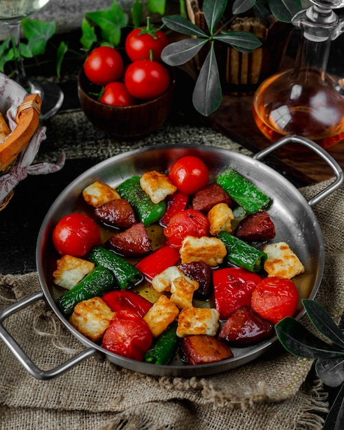 Roasted sausage and vegetables in pan Free Photo
