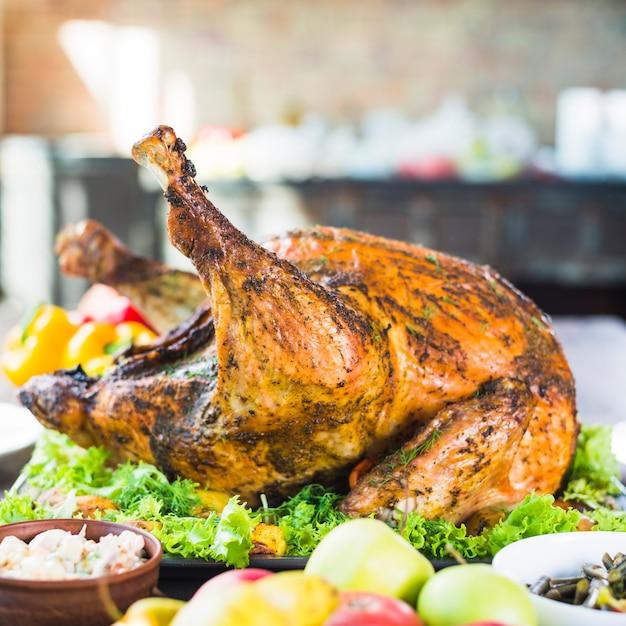 Roasted turkey with food on table Free Photo