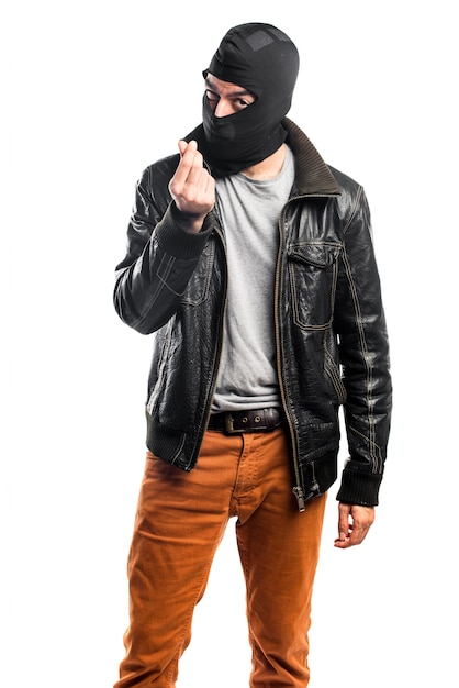 Robber doing a money gesture Free Photo