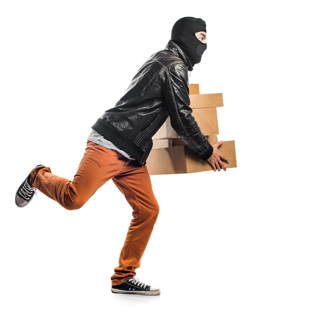 Robber holding boxes Free Photo
