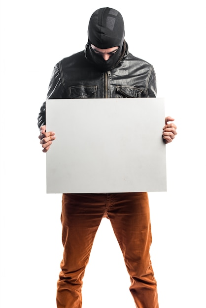 Robber holding an empty placard Free Photo