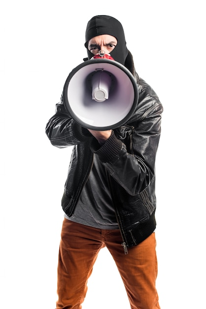 Robber shouting by megaphone Free Photo