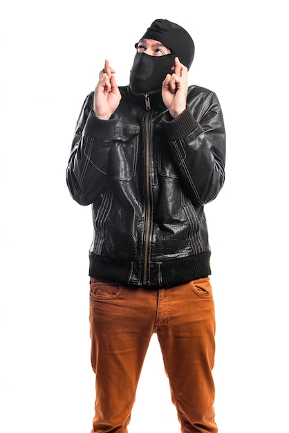 Robber with his fingers crossing Free Photo