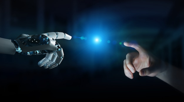 Robot hand making contact with human hand on dark background Premium Photo