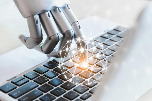 Robot hands and fingers point to technology laptop button advisor chatbot robotic artificial intelligence concept Premium Photo
