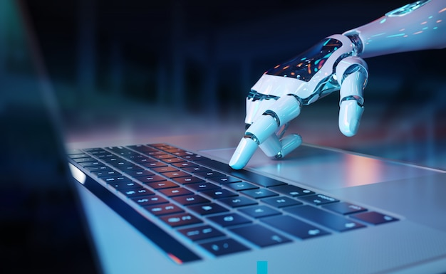 Robotic hand pressing a keyboard on a laptop Premium Photo