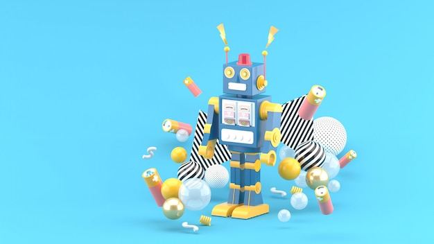 The robots are among the batteries and colorful balls on the blue space Premium Photo