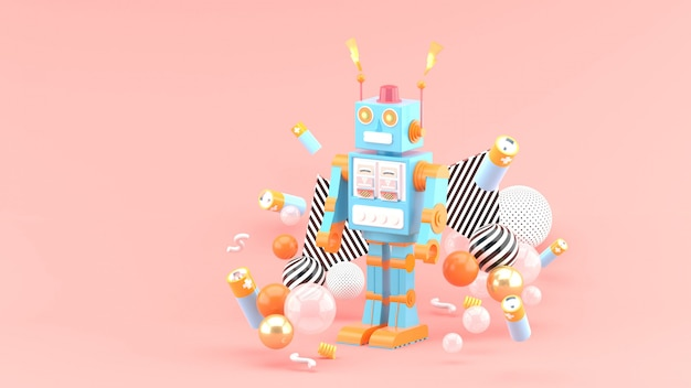 The robots are among the batteries and colorful balls on the pink space Premium Photo