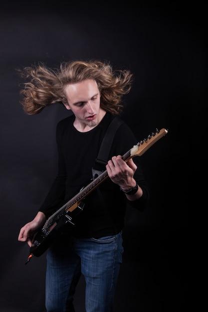 Rock band artist playing guitar Premium Photo