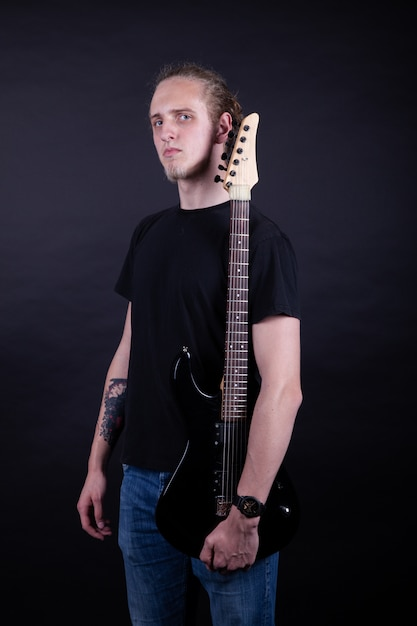 Rock band artist with guitar Premium Photo