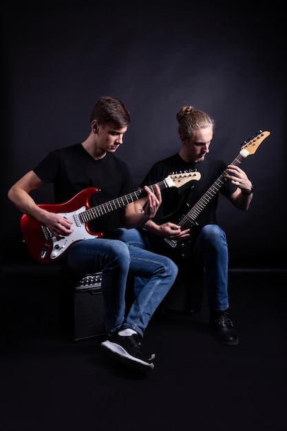 Rock band artists playing guitars Premium Photo