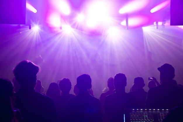 Rock band silhouettes on stage at concert. Free Photo