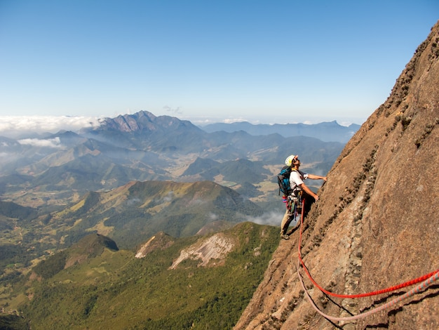 Rock climber climbing a sloping rock wall in brazil Premium Photo