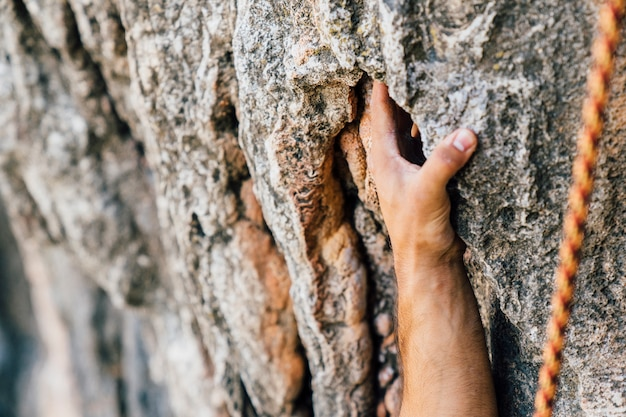 Rock climbing concept with hand Free Photo