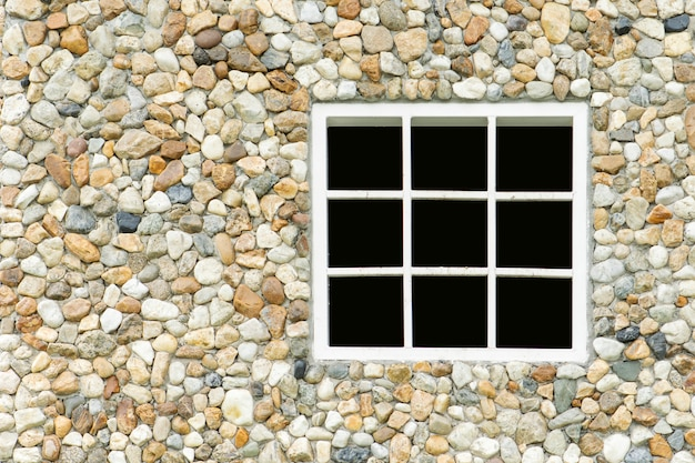 Rock wall with white window background Premium Photo