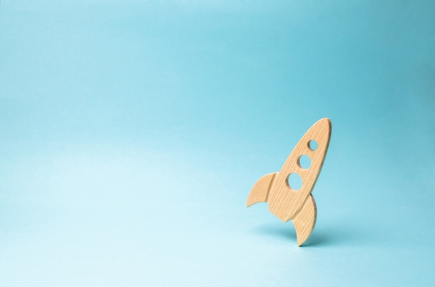 Rocket on a blue background. the concept of a startup, education and the desire to research. Premium Photo