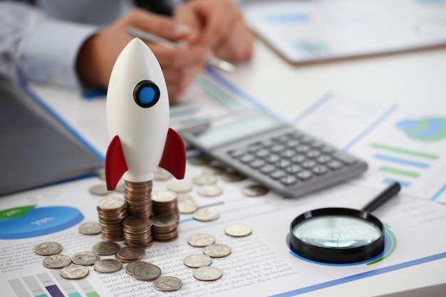 Rocket at start of quarter stands on table Premium Photo