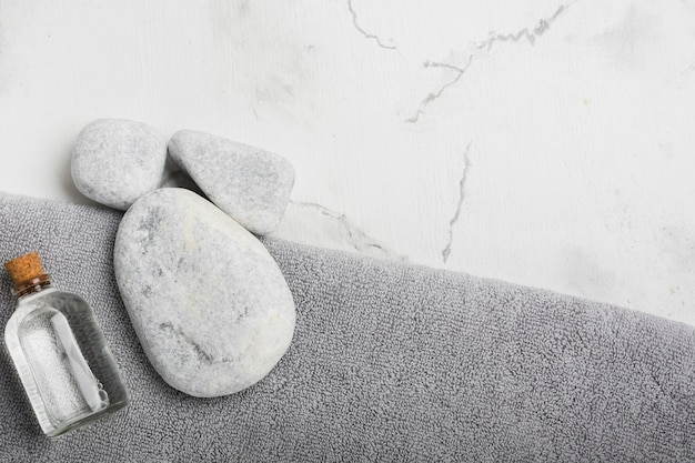 Rocks and container on towel Free Photo