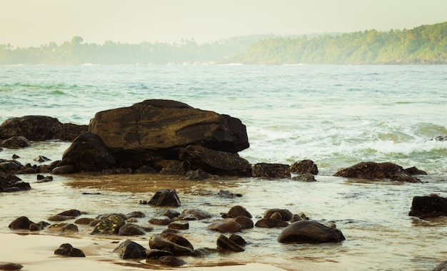 Rocks in an ocean bay with waves Premium Photo