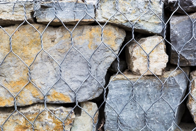 Rocks and stone with metal fence Free Photo