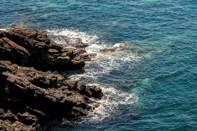 Rocky coast with turquoise sea Free Photo