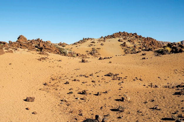 Rocky desert with clear blue sky Free Photo