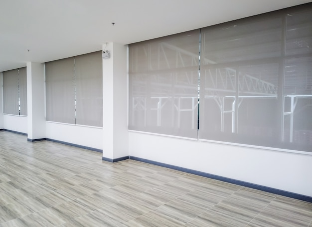 Roll blinds on the windows. window in the interior roller blinds. beautiful blinds on the window Premium Photo