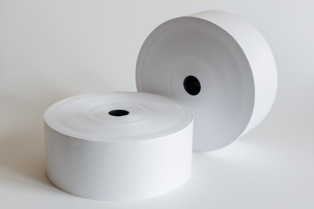 Roll of cash register tape isolated on soft gray. Premium Photo